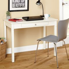 Give your home a cozy study nook with this Simple Living desk. The compact size is ideal for small spaces, and the understated design is available in a variety of finishes to fit any decor. Featuring
