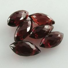2 Garnet AA puff marquise briolette gemstone beads (N) Approximate size range 4 x 9mm to 4.5 x 9.9mm top side drilled: Wholesale, High Quality Gemstone Beads - Magpie Gemstones