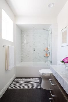 Modern Tub-Shower combo: drop-in bathtub accented with linear white mosaic tiles finished with a glass shower partition. Bathtub Shower Combo, Bathroom Tub Shower, Bathtub Tile, Shower With Tub, Bathtub Doors, Tub To Shower Remodel, Glass Bathroom, Bathroom Mirrors, Remodel Bathroom
