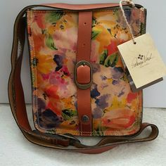 PATRICIA NASH CROSSBODY Beautiful Patricia Nash crossbody from the Heritage Collection.  Colors of oranges, yellows, greens, purples, pinks, and blues.  Front snap closure and adjustable crossbody strap. Inside has 1 zipper pocket and 2 multi-function slots.  Handcrafted leather and large exterior back pocket.  New with tags. PATRICIA NASH  Bags Crossbody Bags