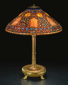 "Tiffany Studios | ""RUSSIAN"" TABLE LAMP -- shade impressed ""TIFFANY STUDIOS NEW YORK 1910""  | Sotheby's"