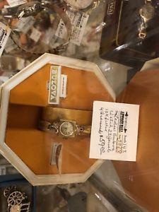 Ladies Bolivia10k filled gold watch in case for $59