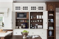 This cabinet, by Humphrey Munson, creates a generous space to serve as a coffee station or storage for for small countertop appliances. Wide, bi-fold doors fold back out of the way to allow the homeowner full access to a large interior work surface. Kitchen Built Ins, Kitchen Storage, Bathroom Storage, Tv Storage, Kitchen Organization, Storage Ideas, Kitchen Post, New Kitchen, Kitchen Pantry