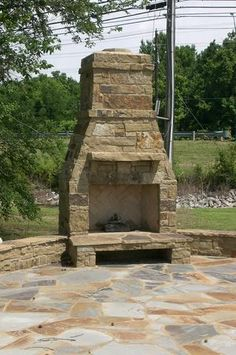 Outdoor Fireplace With OK Hickory Building Stone, And Blue/Brown Flagstone.