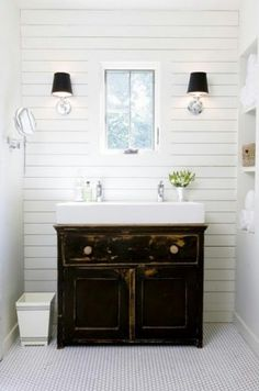 Modern farmhouse style with wood planked walls, trough sink, simple hex tile floors, and swing-arm vanity mirror. The trough sink worked perfectly on an antique cabinet previously used as a dining buffet. Home Interior, Bathroom Interior, Modern Bathroom, Master Bathroom, Small Bathrooms, White Bathroom, Design Bathroom, Interior Design, Basement Bathroom