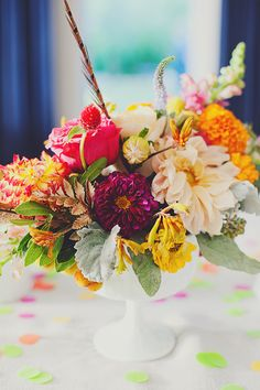 Colorful floral centerpiece {Photo by Our Labor of Love via Project Wedding}