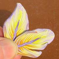 yellow and violet feather polymer clay cane