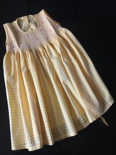 Yellow frock with smocking and hand embroidery