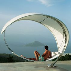 The Petiole Hammock : This self-suspended hammock is the culmination of 20 years of research and design. Handmade in Sweden, the entire hammock is supported by a 9 1/2' electropolished 304 stainless steel pole that is curved to form a half circle, enabling both ends of the bed to be hung from the pole. The sheer canopy blocks up to 86% of UV rays yet allows you to gaze at the sky, creating the relaxing sensation of swaying gently under the canopy of a tree. Strong enough to hold 1/4 tonne.