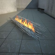 Steel rod, Fire feature by Elena Colombo, seen on http://www.contemporist.com