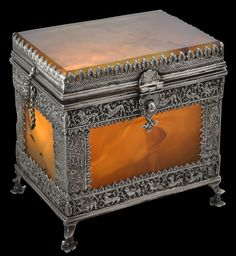 Indian Agate Box with Chased Silver Mounts, circa 1700. This extraordinary box is one of the more unusual items of Indian workmanship to have come to light in recent years. Each side, including the base, is of a large, flat piece of agate (or possibly closely related sardonyx which has been mined in India for thousands of years), and each side is bordered with silver mounts that have been chased and engraved. Find this and other important Asian Art on CuratorsEye.com
