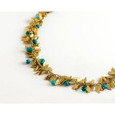 Gold Leaf Necklace with green and turquoise stones ($84) ❤ liked on Polyvore featuring jewelry, necklaces, gold jewelry, leaf jewelry, green gold jewelry, green jewelry and leaves necklace