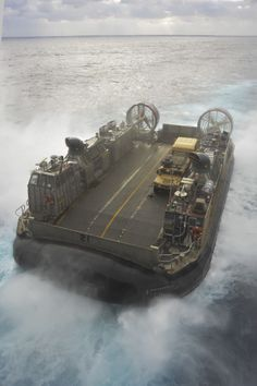EAST CHINA SEA (March 5, 2014) Landing Craft Air Cushion (LCAC) 21 propels through the East China Sea after departing the well deck of the  amphibious assault ship USS Bonhomme Richard (LHD 6). Bonhomme Richard is the flag ship of the Bonhomme Richard Amphibious Ready Group and, with the embarked 31st Marine Expeditionary Unit (31st MEU), is conducting joint force operations in the U.S. 7th Fleet area of responsibility. (USN Mass Comm Spec 2nd Class Adam D.Wainwright)