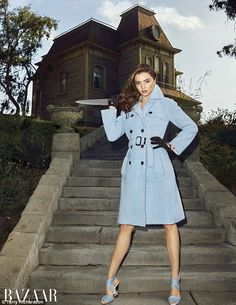 Killer style: Miranda Kerr, 32, wields a knife, while modeling a Fendi trench coat and mat...