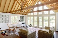 living room cathedral ceiling ideas exposed wooden beams area rug armchairs