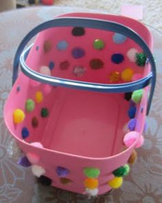 Learn with Play at Home: Toddler pom-pom push, push just enough to stick in the hole but not go through