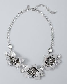 A rose by any other name could never be as glam as this flower statement necklace, punctuated by blackened silvertone metal and gleaming black and clear faceted crystals.