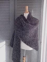 A simple shawl that is all knit stitch. It is perfect for knitting while watching TV and/or reading and catching up on the posts in you favorite Ravelry forum group.