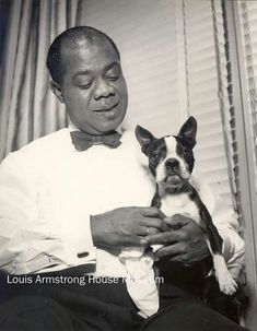 """Louie Armstrong """"Satchmo"""" with his Boston Terrier dog"""