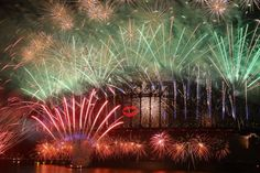 Fireworks light up the sky from The Sydney Harbour Bridge at midnight during New Years Eve celebrations on Sydney Harbour on December 31, 2012 in Sydney, Australia. (Cameron Spencer/Getty Images)