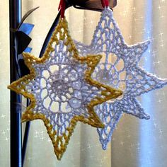 Christmas in thread crochet- Heritage Heartcraft's pattern collection of angels, stars, and more to dress up your tree for the holidays.