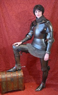 15th Century armour, made of 1050 hardened steel. A good armour should fit and follow the form of the body really well allowing the wearer to be comfortable and move athletically.  Created by Jeff Wasson, the model is his wife, Stacy.  They both joust.