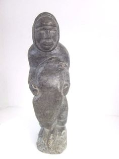 "#InuitEskimo Art vintage Carved Sculpture of a Man and Seal; great details. Guaranteed authentic Native signed piece, 10"" tall, very heavy and substantial."