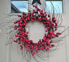 Berries & Grapevine Sunburst Christmas Wreath - TownandCountrymag.com
