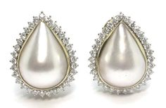 1950's Mabe Pearl & 1.75ct Diamond 18k Yellow & White Gold Earrings | New York Estate Jewelry | Israel Rose _ The earrings are set with two lustrous tear drop mabe pearls. The pearls are accentuated by approximately 1.75ct of round cut diamonds. The color of the diamonds is F-G with VS1 clarity. The measurement of the earrings is 25mm by 19mm and they weigh 15.1 grams.
