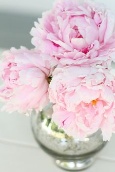 Pink peonies in distressed silver vases.  via We don't sleep when the sun goes down.