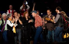 From left to right, Arlo Guthrie, Joan Baez, Bruce Springsteen, Patti Scialfa, Pete Seeger, Dave Matthews, and Tao Rodriguez celebrated onstage at Pete Seeger's 90th birthday concert at Madison Square Garden in New York in 2009.