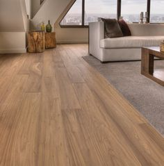 Carlisle Wide Plank Flooring in distressed walnut. I like this lighter color for a beach house.