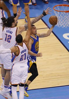 Oklahoma City\'s Steven Adams (12), Andre Roberson (21) defend as Golden State \'s Stephen Curry (30) goes up for a basket during Game 3 of the Western Conference finals in the NBA playoffs between the Oklahoma City Thunder and the Golden State Warriors at Chesapeake Energy Arena in Oklahoma City, Sunday, May 22, 2016. Photo by Sarah Phipps, The Oklahoman