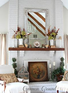 white-brick-fireplace-with-mantel-decorated-for-fall