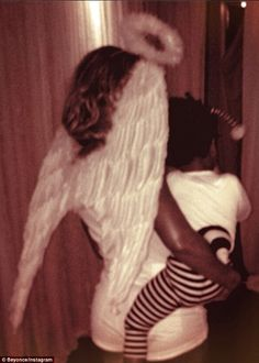 Angelic Beyonce cradles her little caterpillar Blue Ivy on Halloween