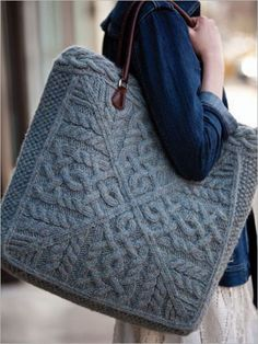 Conterpane cables make up the sides of this oversized knitted tote. The bag features a dense knit in a blend of llama/wool yarn, great structure, a fabric lining and leather handles, making it perfect for carrying large and heavy objects.