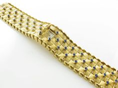 GUBELIN Gold and Sapphire Covered Watch Bracelet   From a unique collection of vintage wrist watches  $14,500       at http://www.1stdibs.com/jewelry/watches/wrist-watches/