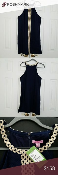 NWT Lilly Pulitzer Sasha Shift Dress This beautiful Lilly Pulitzer Sasha Shift Dress is halter styled with gold embroidery on true navy. Fabric is 100% cotton so perfect for  summer days. No trades.Smoke and pet free home. Reasonable offers accepted. Thanks for visiting my closet. Lilly Pulitzer Dresses