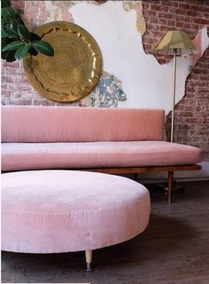This blush velvet sofa adds a sweet touch of color to your room.