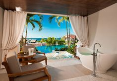 Italian Swim up Bi-level 1 Br. Butler Suite with Veranda Tranquility Soaking Tub. -Let Custom Memories Travel plan your dream getaway today!