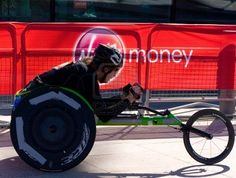 LONDON - APRIL 22: Unidentified wheelchair racers at the London marathon on April 22, 2012 in London, England, UK. The marathon is an annual event. Stock Photo