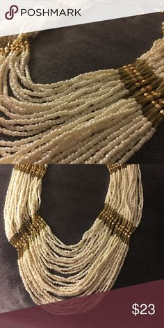 Seed Beaded Long Necklace Color: Pearl/Gold Tone. Multi Strand Chain Handmade Silver Tone Seed Beads Pendant Long Necklace. Ready for casual or classy wear Jewelry Necklaces