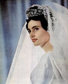 PRINCESS MARIE BOURBON de PARME MARRIES PRINCE ÉDOUARD de LOBKOWICZ  ~ January 1960 at Notre Dame de Paris. The bride wore a dress in satin by Jaques Heim with a 21 foot train.  She wore an imposing diamond tiara from the Bourbon-Parme family.