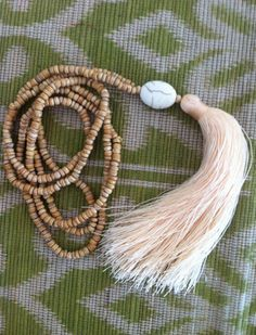 This listing is for one Wooden Beaded Tassel Statement Necklace with a single stone statement bead and Tassel.    This handmade necklace features 4mm