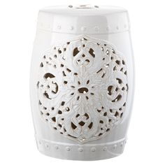 Showcasing a cutout floral medallion and white finish, this ceramic garden stool brings classic appeal to your home library or office.