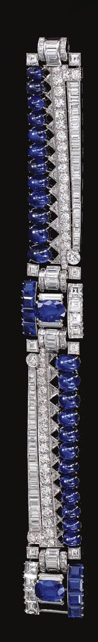 SAPPHIRE AND DIAMOND BRACELET, CIRCA 1950.  Of geometric design, set with graduated lines of cabochon sapphires, triangular, brilliant- and circular-cut and baguette diamonds, embellished by two plaques each centring on an oval sapphire flanked by baguette and square-cut diamonds, to the step-cut stones and calibré-cut sapphires spacers,   length approximately 180mm.