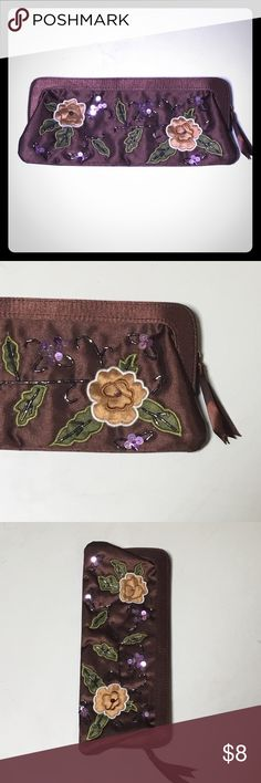 Brown flower beaded satin small clutch purse Brown satin long rectangle clutch, great for evening bag, fit your cash phone lipgloss and money. Zipper closure. Beaded detail on front. Green on insurance inside flower design on front Bags Clutches & Wristlets