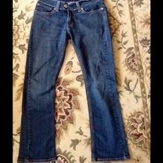 """Genuine Levi's style """"tilted Flare"""" Genuine Levi's style """"Tilted a Flare"""" they are a Boot cut for sure. No signs of wear. Worn a couple of times. Inseam 31"""", total length 39"""" front rise 9 1/2"""" rear rise approximately 12"""". Back button flap pockets. These elongate leg and have a slimming design. True to size. Levi's Jeans"""