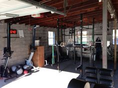 This is a fantastic garage gym - rowers, tmer, rack, ghd.. everything you'd need