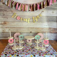 Donut forget to add this hand painted wood, donut cake stand to your donut party shopping list! The stand holds up to an 8 cake (7 cake pictured above) and measures 10.5w x 10.5d x 7h. All of my wood items are hand cut by me, painted with chalk paint or stained with wax, sanded Пончиковая Вечеринка, Идеи На День Рождения, Пончики, Вечеринки Для Взрослых, Малышки, Украшения Сладкого Стола